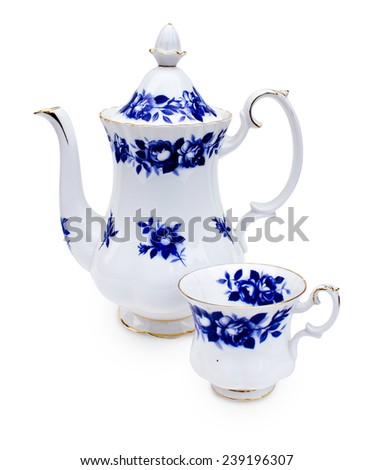 Antique porcelain tea set with floral painting on white background - stock photo