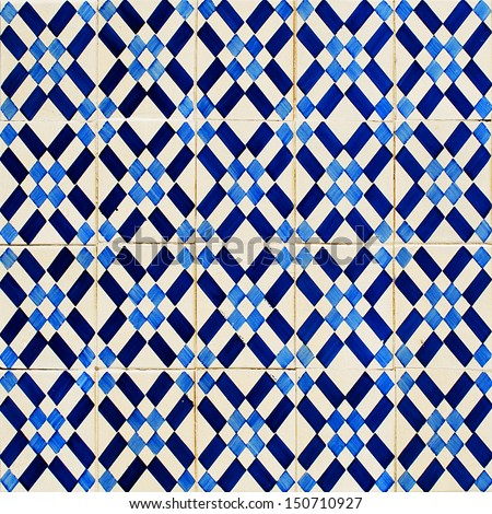 antique portuguese glazed tiles known as azulejos (suitable as a background or texture) - stock photo