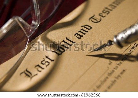 Antique quill and Old-fashioned paper with text of Last will - stock photo
