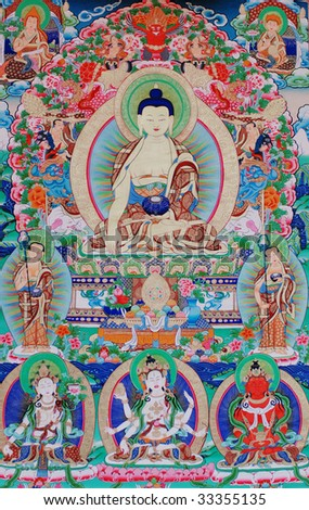 "antique ""Thangka"" : is a painted or embroidered Buddhist banner which was hung in a monastery or a family altar and carried by lamas in ceremonial processions. - stock photo"