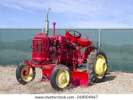 Antique red tractor - stock photo