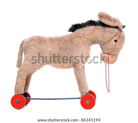 Antique rocking donkey, wooden toy isolated on a white. Traditional christmas gift. Product is 80 years old. - stock photo