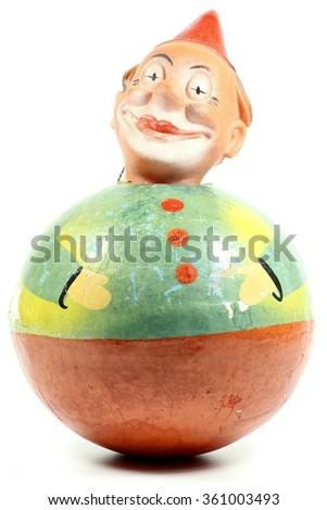 antique roly-poly doll isolated on white background - stock photo