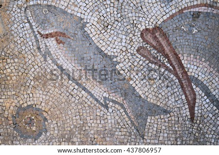 Antique Roman mosaic located in the archeological site of Milreu, Algarve, Portugal - stock photo