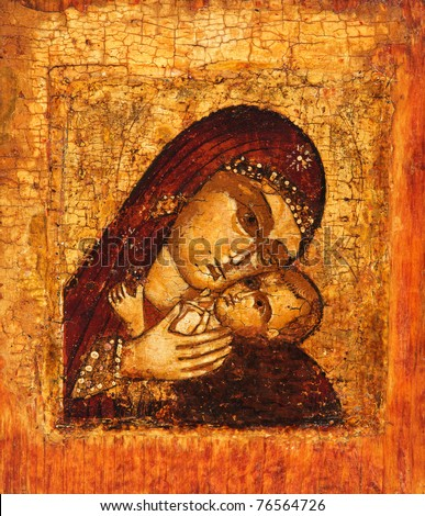 Antique Russian orthodox icon of Mother of God (Mary) and child (Jesus Christ) painted on wooden board. - stock photo