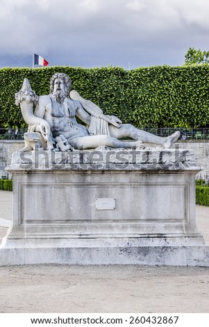 Antique sculpture in Jardin des Tuileries (Tuileries garden) - favorite spot for rest of tourists and Parisians. Garden was created by Catherine de Medici in 1564. Paris, France. - stock photo