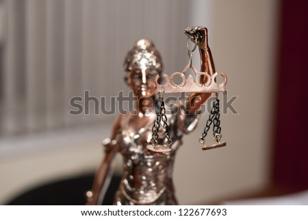 Antique statue of justice - stock photo