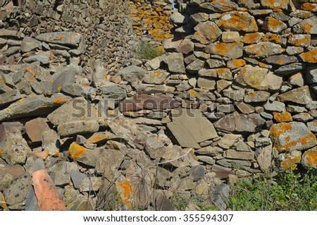 Antique Stone Wall Ruins. Abandoned Decayed structures - stock photo