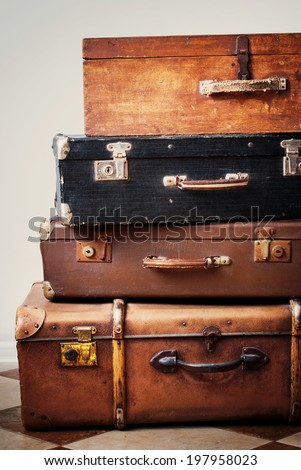 Antique Suitcases in a Stack, Vintage trunks - stock photo