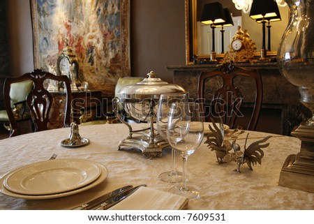 antique tableware and silver soupbowl - stock photo