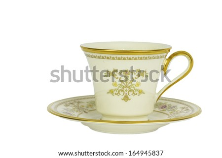 Antique Tea Cup and Saucer Isolated on a white background. - stock photo