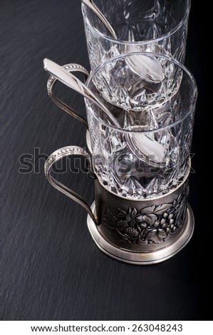 antique tea glass cup holder with a spoon - stock photo