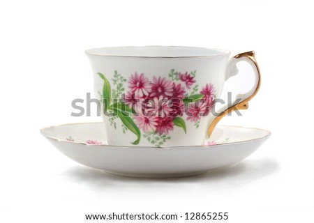 Antique teacup and saucer - stock photo