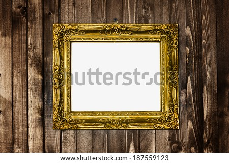 antique texture gold frame hanging on wood wall pattern vignette light - stock photo