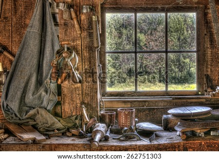 Antique Tools on a Workbench in Front of a Window - stock photo