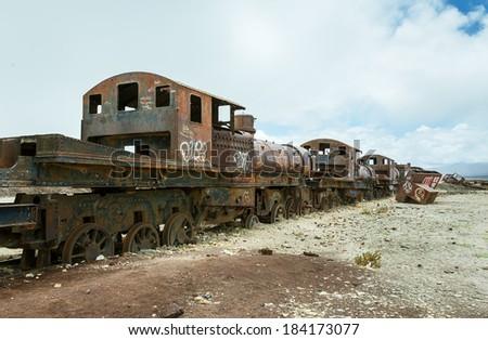 Antique train cemetery - Uyuni, Bolivia - stock photo