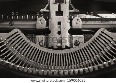 Antique Typewriter - An Antique Typewriter Showing Traditional QWERTY Typebars IX - stock photo