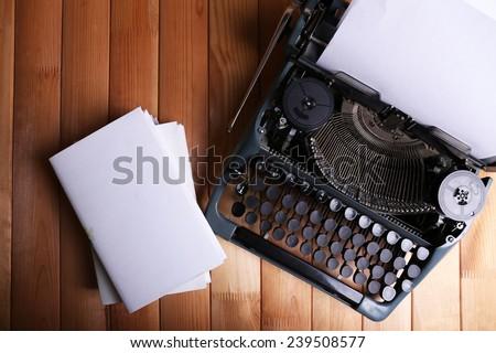 Antique Typewriter. Vintage Typewriter Machine on wooden table - stock photo
