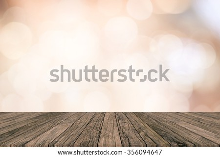 antique vintage brown wood tiles tabletop perspective with blurred bright circle lights background:glitter bulbs backdrop with perspective wooden panels:christmas and new year display picture concept - stock photo
