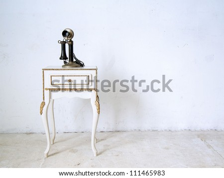 antique, vintage candlestick telephone on a  table ,in white room - stock photo