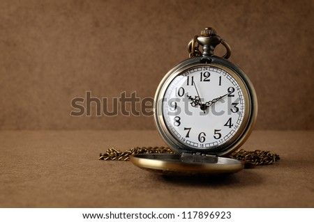 Antique watch on grunge background - stock photo