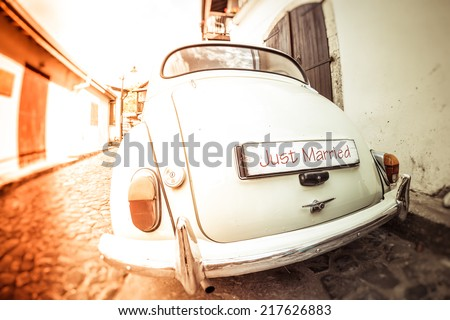 Antique wedding car with just married sign - stock photo