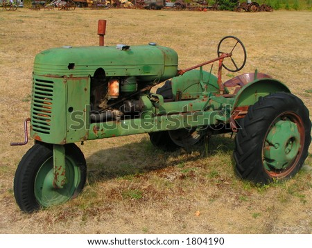 Antique 3-Wheeled Tractor - stock photo