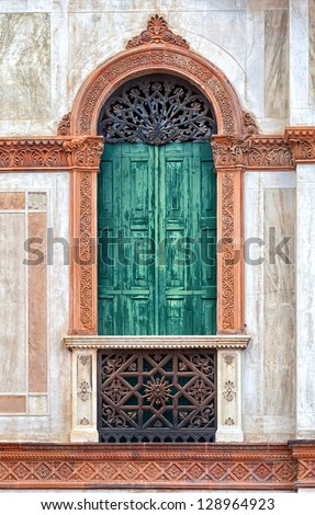 Antique window of venetian palace - stock photo