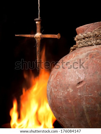 Antique wine jug and an easter cross made of rusty nails symbols of the resurrection - stock photo