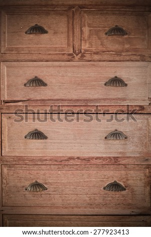 Antique wood carved chest of drawers - stock photo