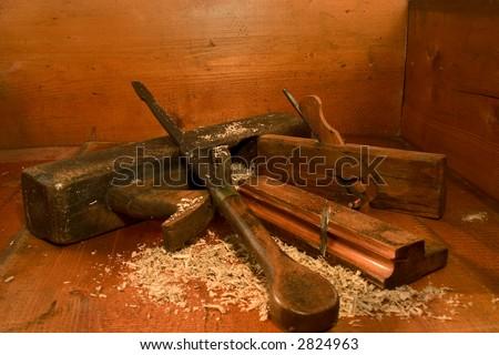 Antique wood plane's & antique screw driver - stock photo