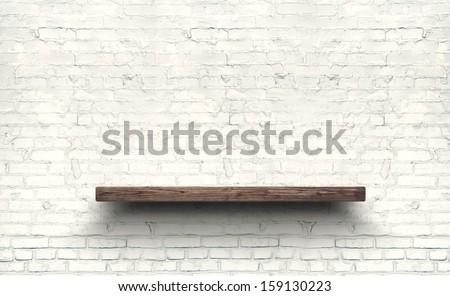 Antique Wooden Shelf on Brick Wall. Old Shelf. Shelf on the Wall. Shelf in Vintage Style, Blank Shelf. Old Board, Old Rack. Wooden Bookshelf. Grunge, Wall, Brick, Empty Shelf. Brick Background. - stock photo