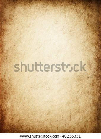 Antique yellowish parchment paper grungy background texture - stock photo