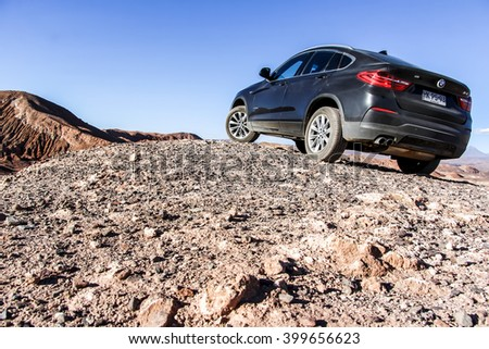 ANTOFAGASTA, CHILE - NOVEMBER 15, 2015: New black crossover BMW F26 X4 at the top of the hill. - stock photo