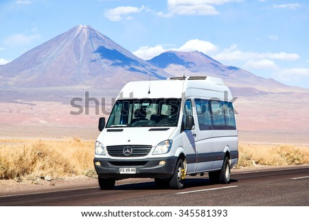 ANTOFAGASTA, CHILE - NOVEMBER 15, 2015: White minibus Mercedes-Benz Sprinter at the background of a volcano. - stock photo