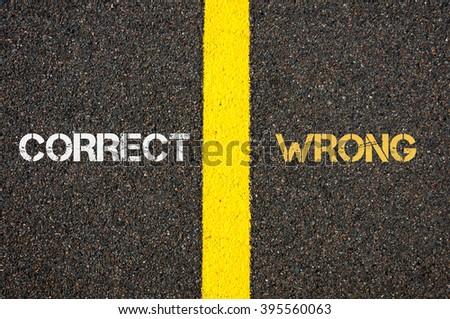 Antonym concept of CORRECT versus WRONG written over tarmac, road marking yellow paint separating line between words - stock photo