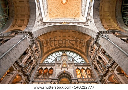 ANTWERP, BELGIUM - APRIL 21:Famous old clock on the facade of the old beautiful railway station in Antwerp. Belgium, also known as the cathedral amongst stations on April 21, 2013 in Antwerp, Belgium  - stock photo