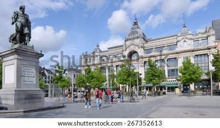 ANTWERP, BELGIUM - JUNE 23, 2013: People in front of monument to Pieter Paul Rubens and the Hilton hotel. The hotel building formerly housed the Grand Bazar Shopping mall  - stock photo