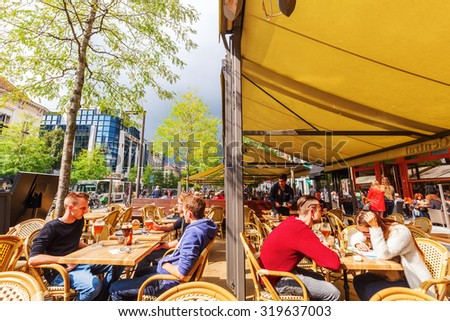 ANTWERP, BELGIUM - SEPTEMBER 03, 2015: street restaurant with unidentified people in Antwerp. Antwerp is the capital of Antwerp province and with a population of 510,610 most populous city in Belgium  - stock photo