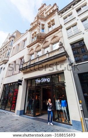 ANTWERP, BELGIUM - SEPTEMBER 03, 2015: unidentified people in front of The Sting store. The Sting is an international fashion chain with 80 stores, it is multi-branded and sells approx. 30 labels - stock photo
