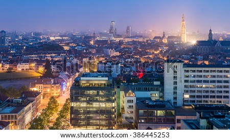 Antwerp City, Aerial View Cityscape Panorama Skyline with cathedral of our lady, St. Paul's Church at night under haze, Belgium - stock photo