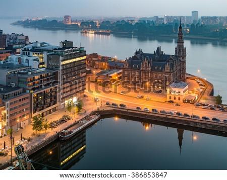 Antwerp City, Aerial View Cityscape Panorama Skyline with Pilotage Building, Bonaparte Dock, Ship, port area with river Schelde, Marguerie Schuilhaven under Haze at Night, Belgium - stock photo