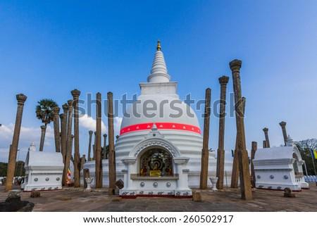 ANURADHAPURA, SRI LANKA - JAN 11, 2015: Thuparamaya is a dagoba in Anuradhapura, Sri Lanka. It is a Buddhist sacred place of veneration. - stock photo