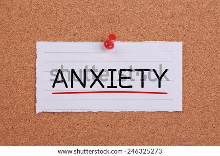 Anxiety note paper pinned on cork board. - stock photo