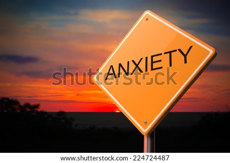 Anxiety on Warning Road Sign on Sunset Sky Background. - stock photo