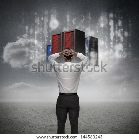 Anxious businessman looking at servers in dark grey landscape - stock photo