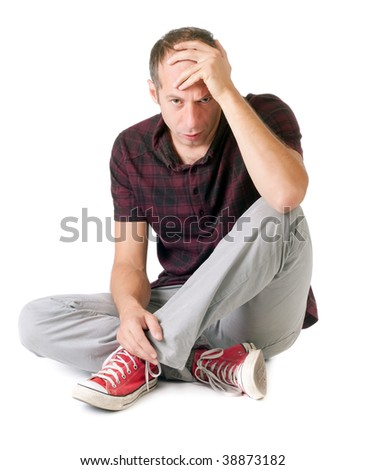 anxious man seated and thinking isolated on white - stock photo