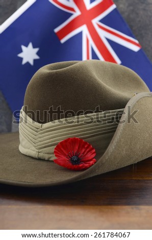 Anzac army slouch hat with Australian Flag on vintage wood background. - stock photo
