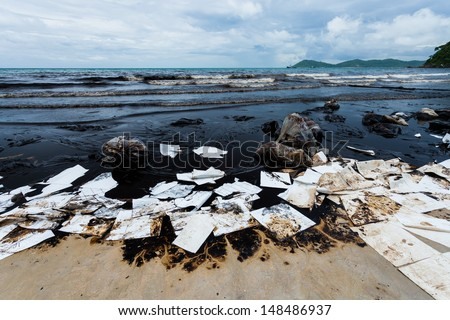 Ao Prao Beach was full of crude oil and absorb paper on oil spill accident on Ao Prao Beach at Samet island on July 31,2013 in Rayong,Thailand - stock photo