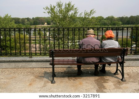 aold people alone on a bench - stock photo